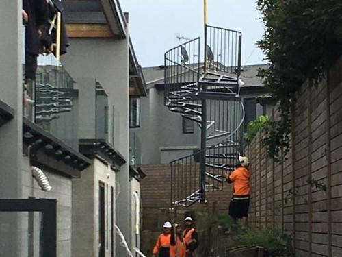 Spiral Staircase manufactured by Otago Engineering maneuvered into position with the help of a crane.