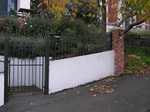 Concrete and wrought iron garden fence