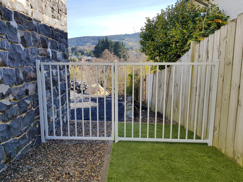 White gate to secure the side of the house