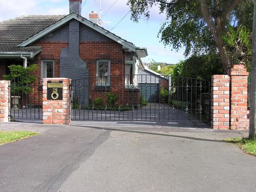 Decorative iron driveway gate