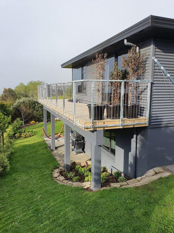 Steel balustrade laced with stainless steel wire made by Otago Engineering.