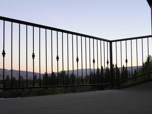 Deck railing with wrought iron detailing
