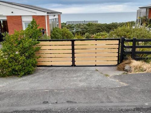Wood and metal gate by Otago Engineering