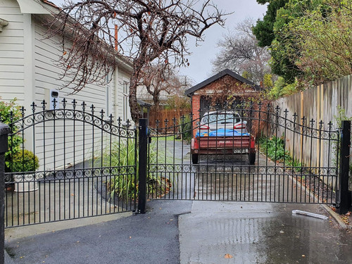 Beautiful sweeping wrought iron gate and fence