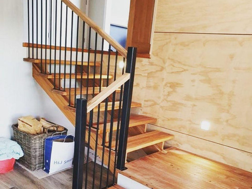Internal balustrade with wooden top rail