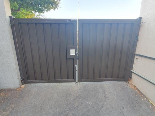 Solid metal self-closing gate