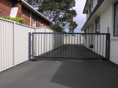 Black swing gate by Otago Engineering