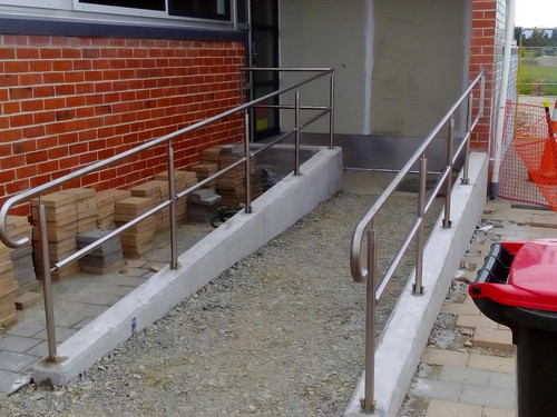 Handrail at a ramp to prevent falls