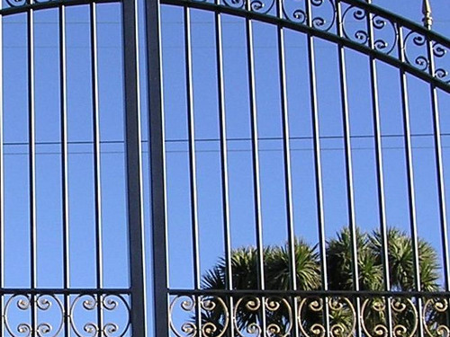Wrought iron gate in a classic arch shape