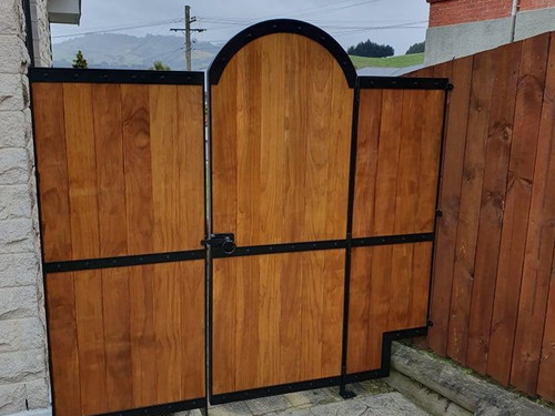 Steel framed gate with wood inserts