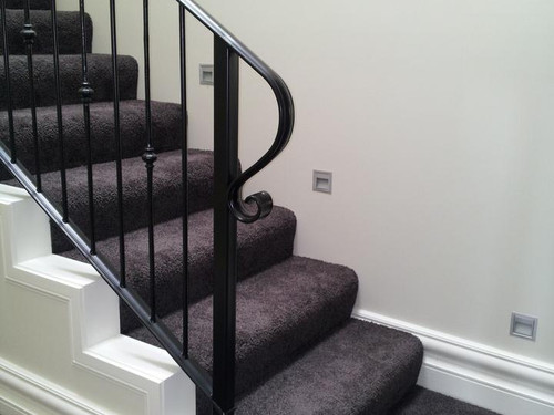 The curved end of the balustrade custom-made and installed