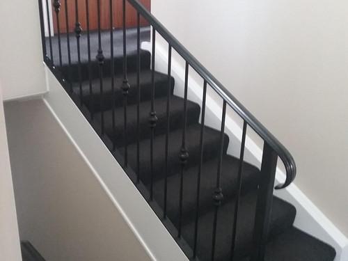 Black handrail on stairs