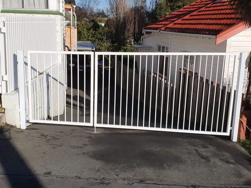 White metal swing gate