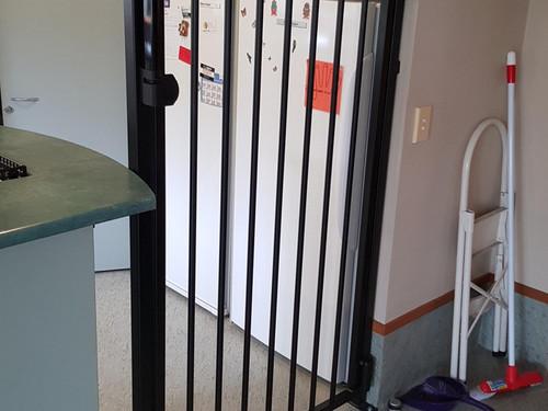 Child safety gate in kitchen