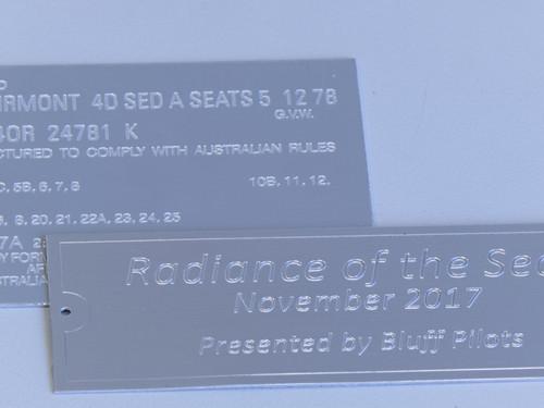 Engraved metal signs