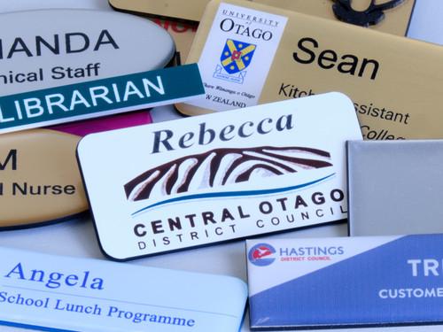 Name tag badges and pins