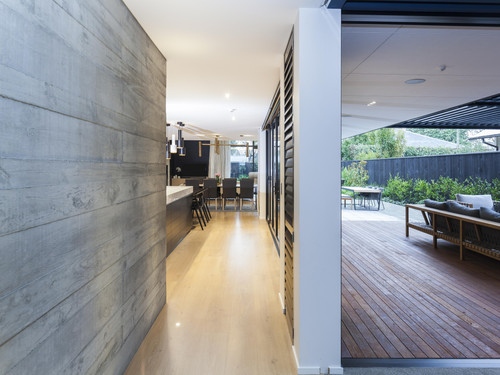 the use of textured concrete tilt panels on the interior and exterior of the house is a noticeable feature