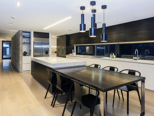 The kitchen features marble, concrete and the finest quality hardware
