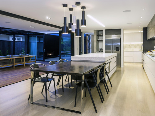 Seamless indoor and outdoor flow from the kitchen to outdoors with a feature outdoor fireplace