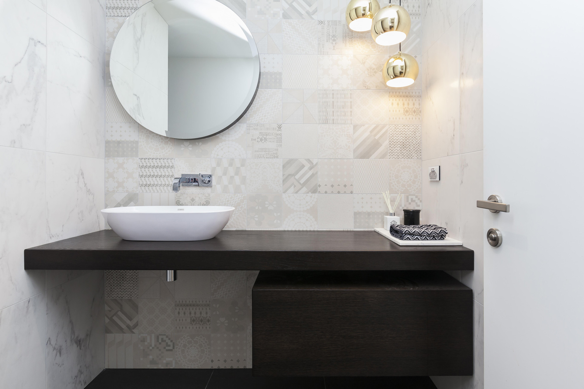 Quality hardware, fittings, mosaic tiling and marble make for a beautiful bathroom