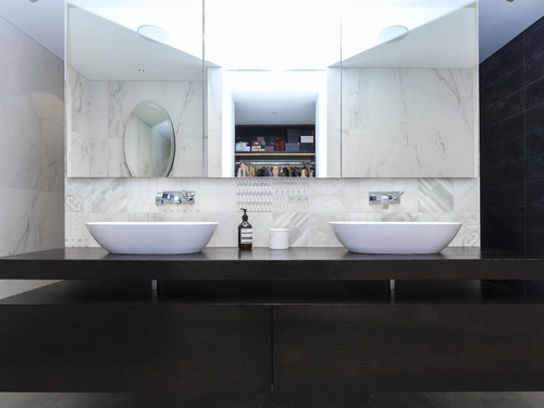 The master bathroom featuring his and hers vanities