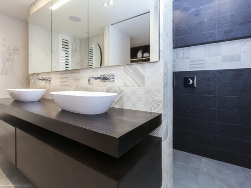 Mosaic tiles and textures add interest to the master bathroom