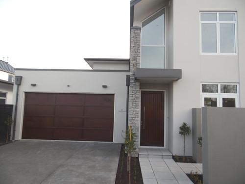 The front door and garage door are constructed of cedar