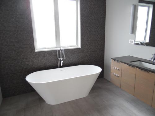 A modern bathtub makes a statement of luxury in the bathroom