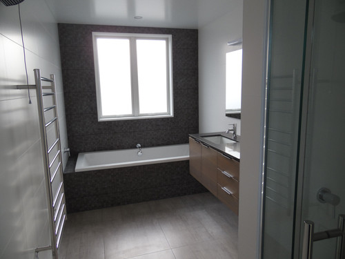 Another bathtub with the same tile work ties the home together