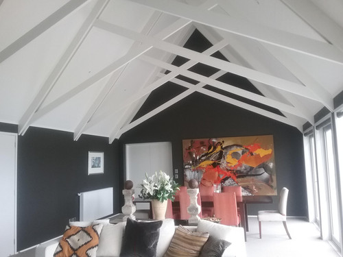 The exposed rafters create symmetry and a real statement