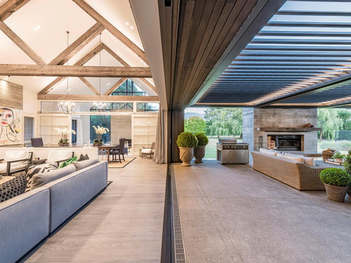 The home features Canadian Oregon exposed rafters restored and created by us on-site