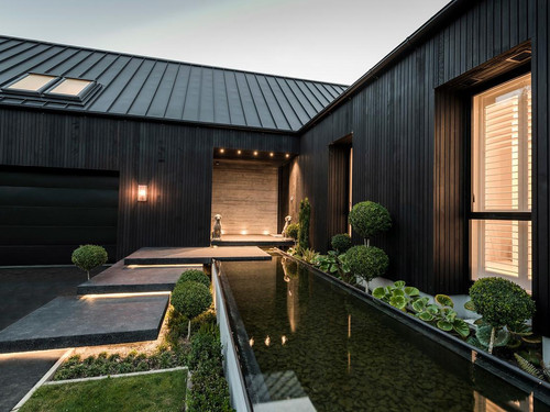 Ohoka by night with the exterior featuring grooved cedar weatherboard