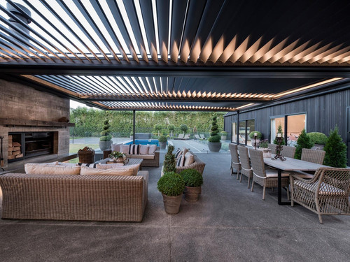 The outdoor area featuring hand-crafted outdoor fireplace