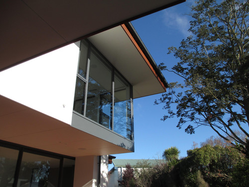 Large windows with overhanging soffits contrasting with hand-crafted cedar fascia.