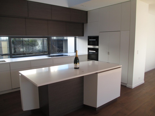 Interior designed kitchens include timber flooring and granite bench tops