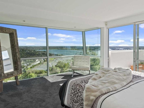 Bedroom views enhanced with large-scale windows