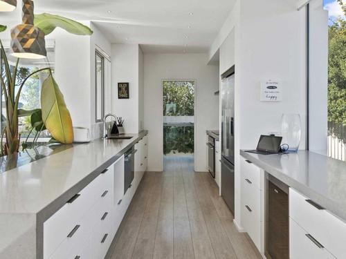 Galley style kitchen design with glass door
