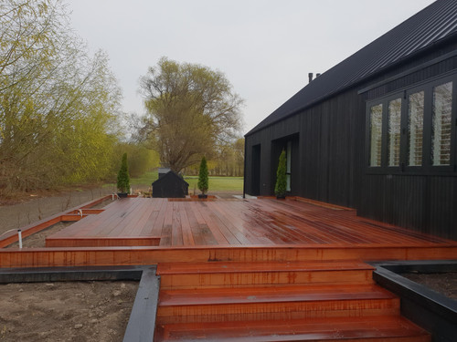 A raised decking with boxed in gardens