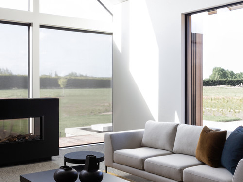 The light and bright living area with full height feature window