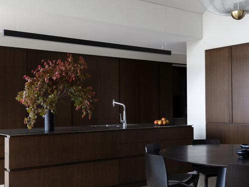 With interior design by Lume Design the dark chocolate interiors add warmth