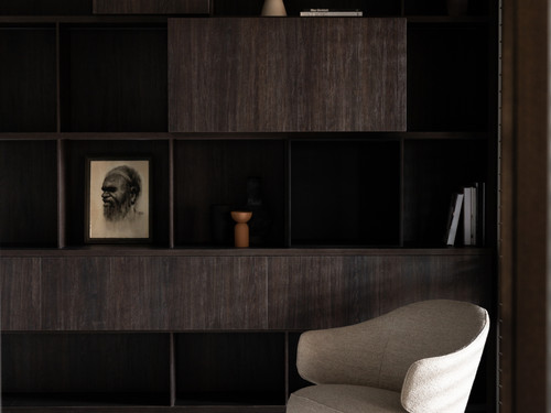 An intimate sitting area features beautiful dark cabinetry