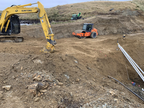 A excavator and machines hard at work