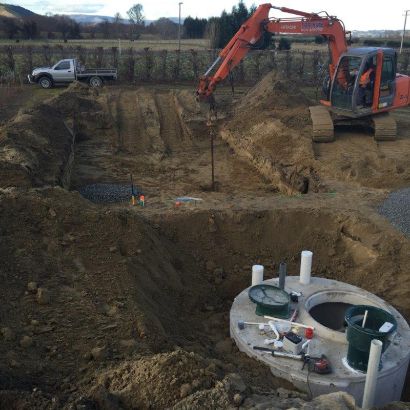 A digger helping with the installation of a septic tank