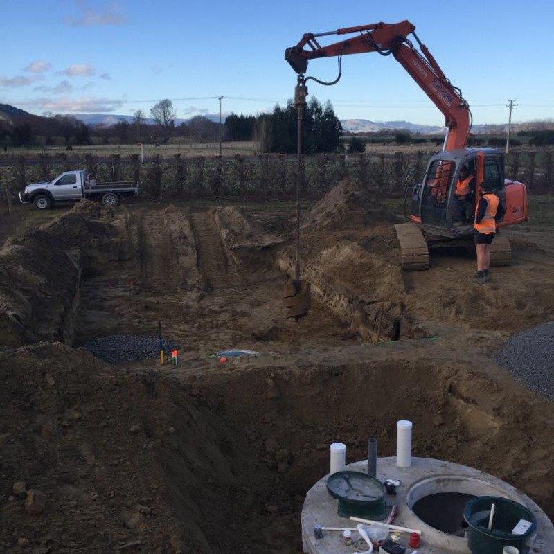 Hard at work installing a septic tank
