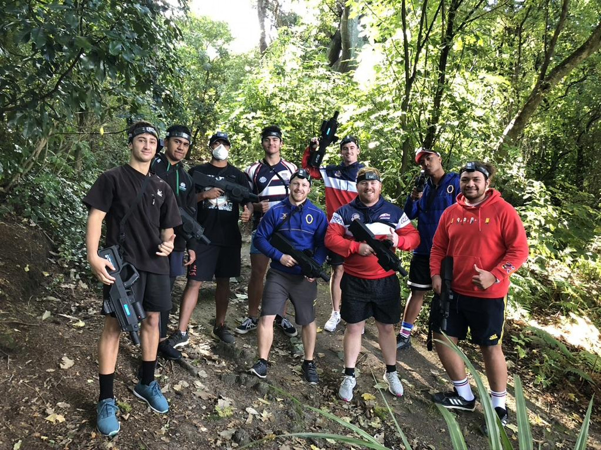 A great crew after a fun game of Battle Combat in the bush around Dunedin