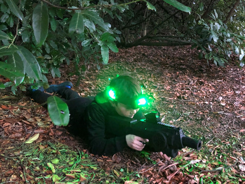 The headband lighting up in Battle Combat laser tag as it starts to get dark