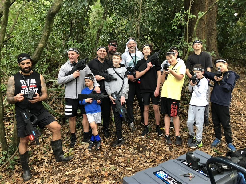 Dads and sons play Battle Combat laser tag