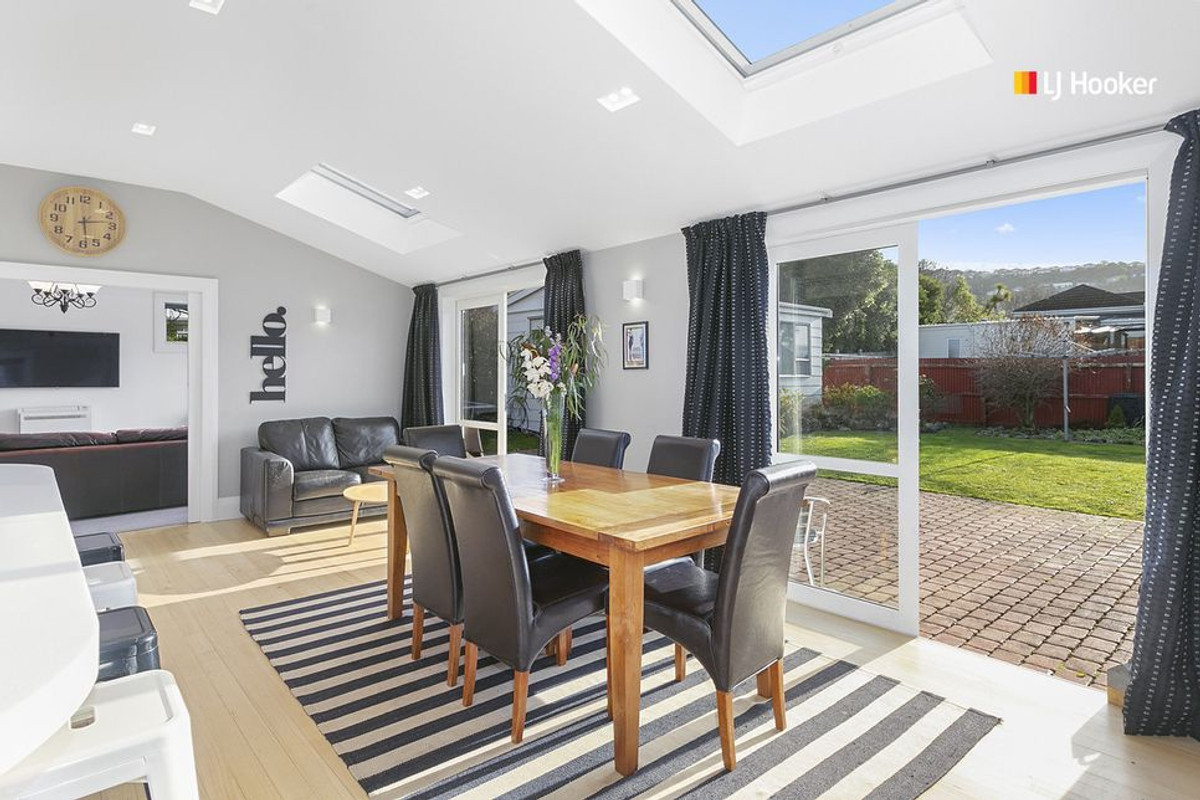 Skylights and sliding doors bring the outside in and help this home to have great flow
