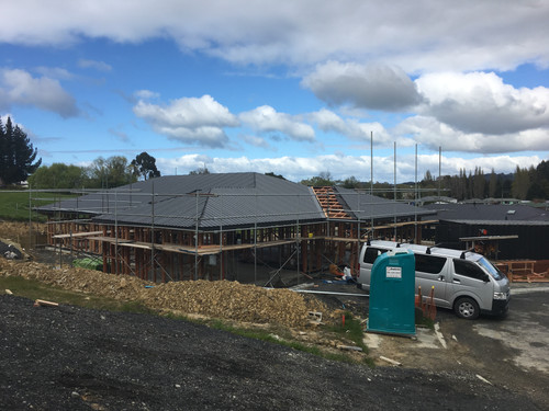 The scaffolding is up and the roof is going on