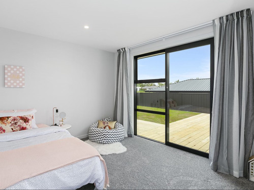 Bedroom with sliding door and a deck area